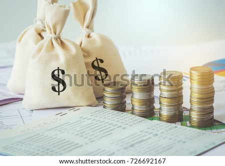 Money saving and money bag with coin stack growing business. #726692167