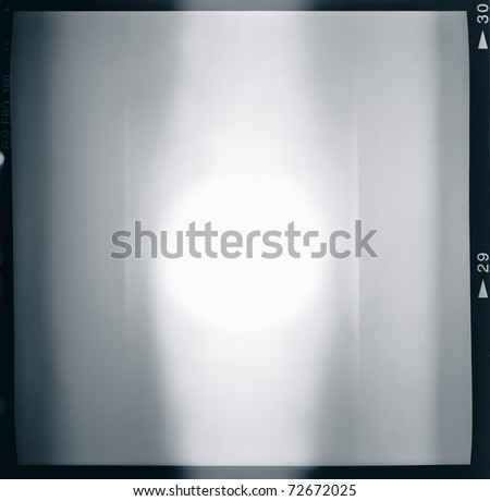 Blank medium format (6x6) film frame with abstract monochrome filling, containing lightleak in the center