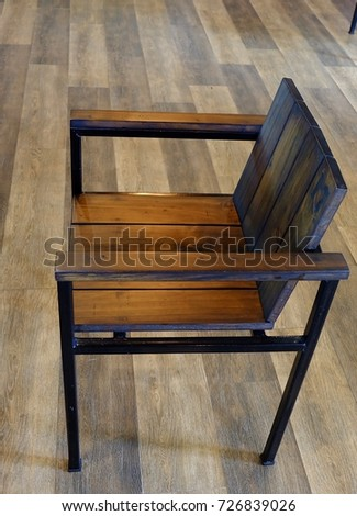 Wooden chair on wood background. #726839026
