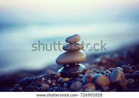 Zen stones balance. Harmony and peace silence. Rocks on the coast of the sea. Stock Photo.