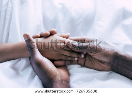 partial view of african american father and son holding hands together #726935638