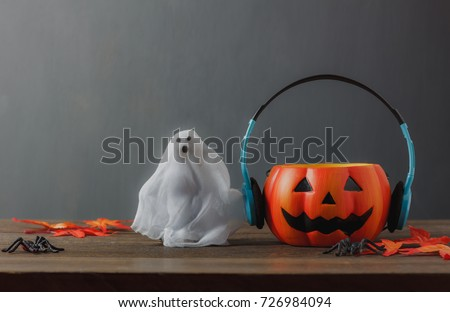 Happy Halloween festival decorations and music concept.Mix different of accessories on modern rustic brown wooden at home office desk.Blur grudge grey wallpaper background after object and copy space #726984094
