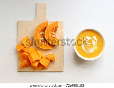 Bowl of butternut squash soup on a white background,isolated,squash soup,top view #726985153