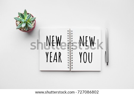 New year new you text on notepad with office accessories.Business motivation,inspiration concepts #727086802