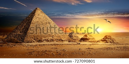 Egyptian pyramids in sand desert and clear sky. Royalty-Free Stock Photo #727090801