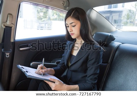 Asian Woman working with serious emotion in Car, Woman working concept. #727167790