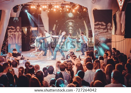 Odessa, Ukraine August 23, 2014: Ibiza Night club dj party people enjoy of music dancing sound with colorful light, smoke machine, lights show and Baldinini fashion sow on stage. #727264042