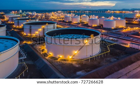 Aerial top view storage tank farm at night, Tank farm storage chemical petroleum petrochemical refinery product at oil terminal, Business commercial trade fuel and energy transport by tanker vessel. #727266628