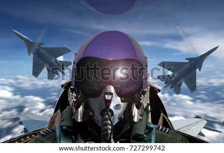 Fighter pilot cockpit view during sunrise