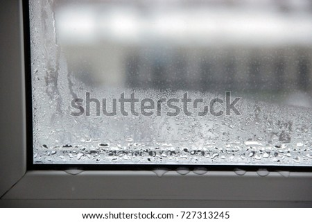 Condensation on the window Royalty-Free Stock Photo #727313245