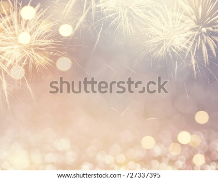 Gold Vintage Fireworks and bokeh in New Year eve and copy space. Abstract background holiday. #727337395