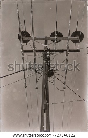 in  australia the concept of power line with electrical pole in the clear sky #727340122