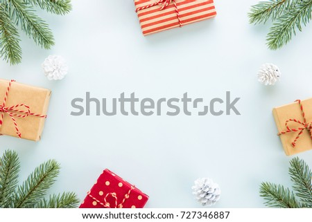 Christmas and New Year holiday background with copy space, creative idea border design with gift boxes, green pine and decorating items
