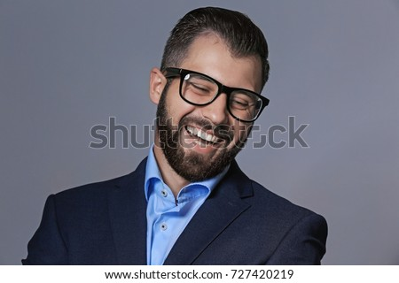 Handsome man in formal clothes on grey background #727420219