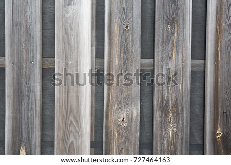 rustic weathered barn wood background with knots and nail holes #727464163