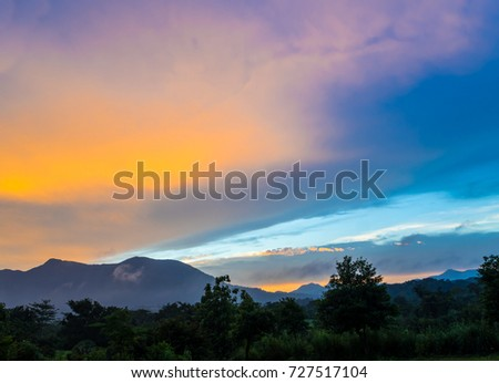 Vivid color of Sky and Clouds drifting over the forest mountain in evening time #727517104