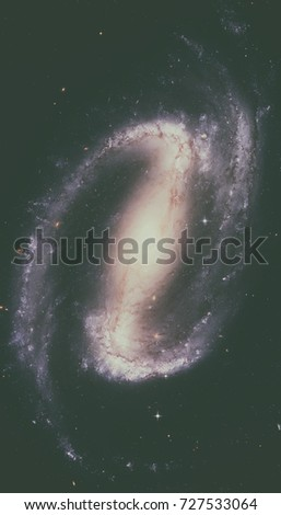 NGC 1300 is a barred spiral galaxy in the constellation Eridanus. Retouched image. Elements of this image furnished by NASA. #727533064