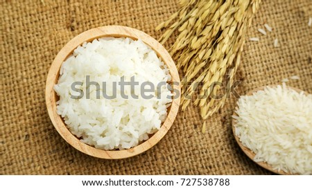 Jasmine rice in a bowl on a wooden table. #727538788
