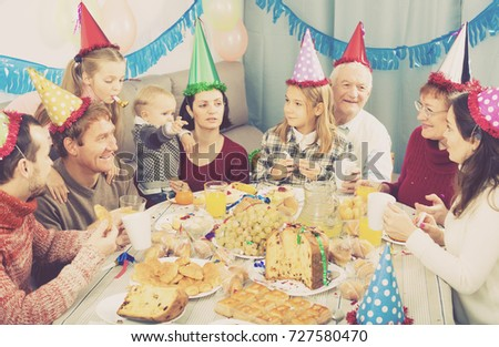 Family behaving jokingly during childrenâ??s birthday party #727580470