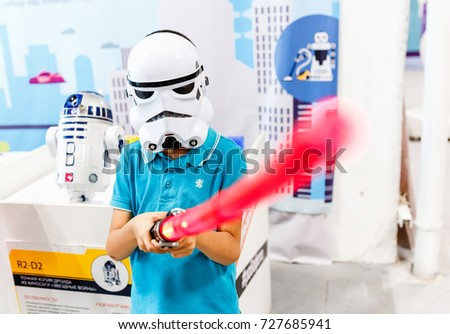 ULTRA MALL, UFA, RUSSIA, 21 AUGUST, 2017: A boy in a mask and suit of a stormtrooper with a laser sword depicts the hero of the movie Star Wars #727685941