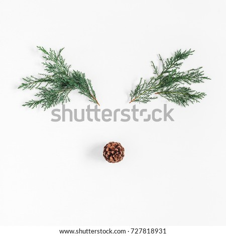 Christmas decoration. Christmas deer made of pine branches and pine cone on white background. Flat lay, top view, square #727818931