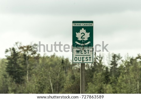 Signpost with green sign of Trans Canada 2 Highway west direction connecting the east- and west coast