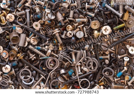 miscellaneous hardware parts including screws washers and springs all jumbled in a pile Royalty-Free Stock Photo #727988743