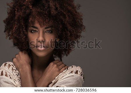 Beauty portrait of african american woman with afro hairstyle and glamour makeup. #728036596