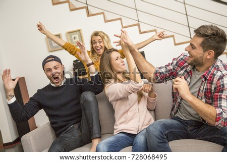 friends in front of tv watching game #728068495