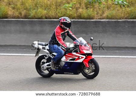 FRANKFURT,GERMANY-SEPT 30:Unknown rider on the freeway on September 30,2017 in Frankfurt,Germany. #728079688