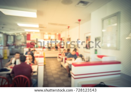 Blurred image a compact fast food restaurant in USA. #728123143