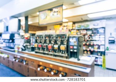 Blurred modern convenience store gas station in Arkansas, USA. Variety items on display such as impulse snack, energy drink, coffee, hot food, tobacco, cigarette, clothes, lottery ticket. Vintage tone Royalty-Free Stock Photo #728183701