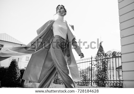 young beautiful stylish woman walking in street in blue coat, autumn fashion trend, smiling, happy. Royalty-Free Stock Photo #728184628