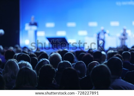 Audience at the conference hall. Business Conference and Presentation Royalty-Free Stock Photo #728227891