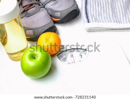 Weight scales, sneakers, handkerchief,water bottle and fruit on white background Selective focus,Conception about health care #728231140