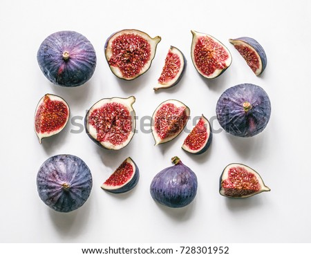 Fresh figs. Food Photo. Creative scheme of the whole and sliced figs on a white background, inscribed in a rectangle. View from above. Copy space #728301952