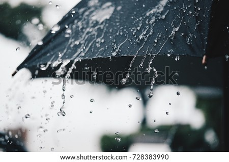 Back Umbrella in the rain in vintage tone Royalty-Free Stock Photo #728383990