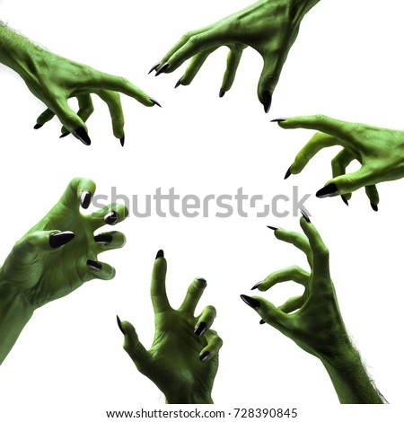 Halloween green witches or zombie monster hands Royalty-Free Stock Photo #728390845