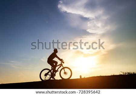 Silhouette young teenager  Asian are cycling a bike at sunset background,copy space #728395642