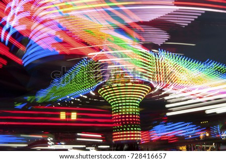 Long exposure photography. Carousel lights and movements, Uk
