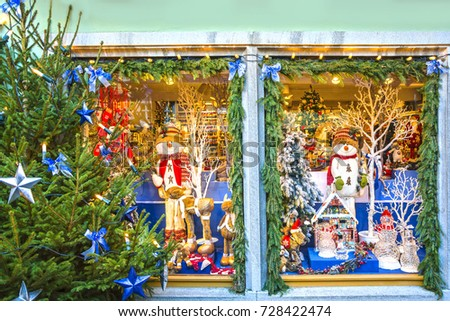 ROTHENBURG OB DER TAUBER, GERMANY - December 13, 2016: Showcase decorated for Christmas holiday with traditional Christmas gifts in street of old fairytale town of Rothenburg ob der Tauber, Bavaria. #728422474