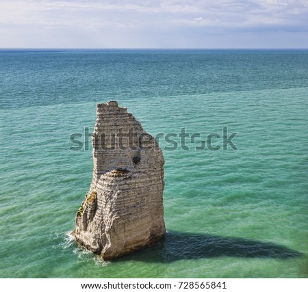 Image of the iconic The Needle Rock from Etretat in Northern France. This is a chalk rock which rises 70 m above the sea level.