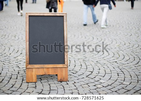Blank restaurant advertising board wood sign on the street , mock up blackboard for design