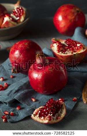Raw Red Organic Pomegranates Splt in Half #728582125