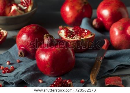 Raw Red Organic Pomegranates Splt in Half #728582173
