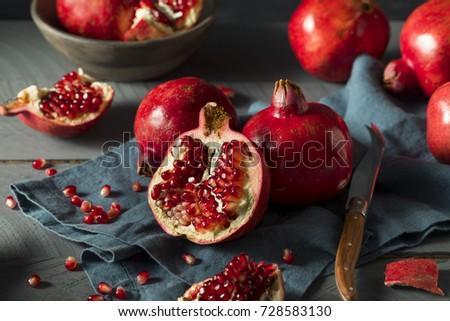 Raw Red Organic Pomegranates Splt in Half #728583130