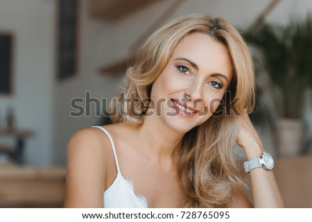 portrait of beautiful happy middle aged woman smiling at camera Royalty-Free Stock Photo #728765095