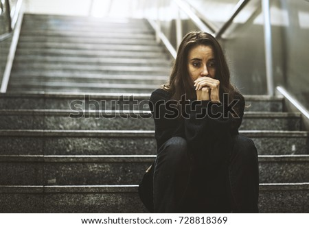 Adult Woman Sitting Look Worried on The Stairway #728818369
