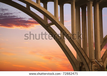 Highway Bridge Arch And Structural Supports Against A Red Evening Sky, The Little Miami River, Ohio, USA Royalty-Free Stock Photo #72882475
