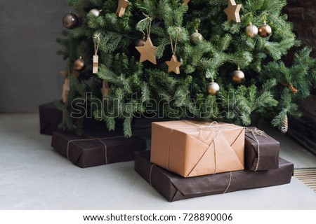 Christmas tree with wooden rustic decorations and presents under it in loft interior. #728890006